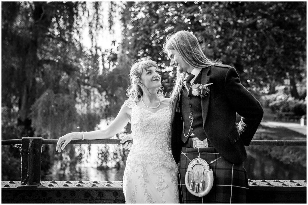 Black and white couple portrait on bridge