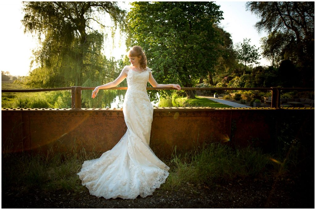 Bride portrait on bridge by river golden hour light