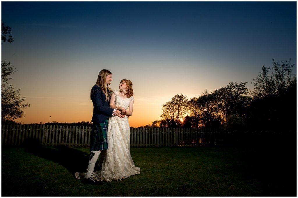 Couple portrait flash lit at sunset
