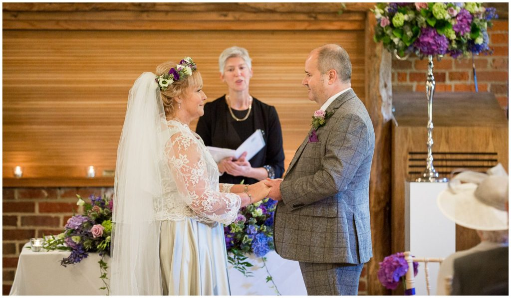 The couple turn to face each other to make their vows