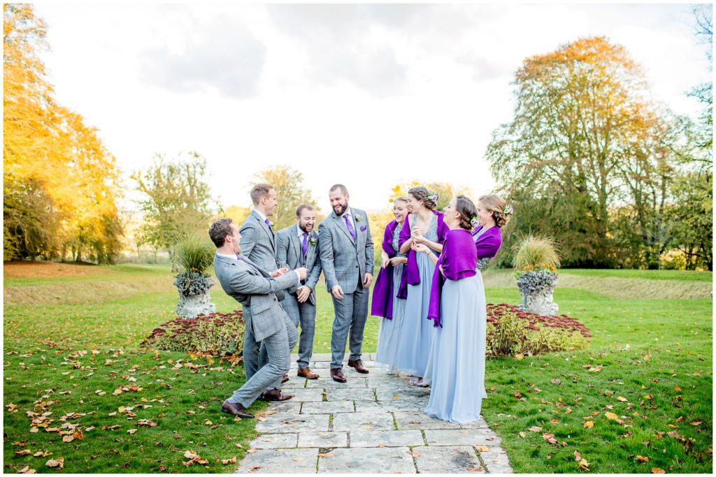 Groomsmen and bridesmaids in hotel gardens