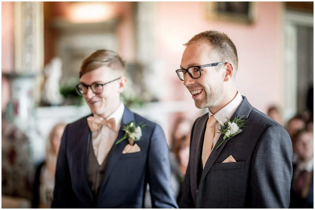Two grooms in ceremony room
