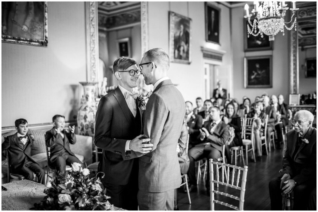 Black and white image of the two grooms at Winchester gay wedding