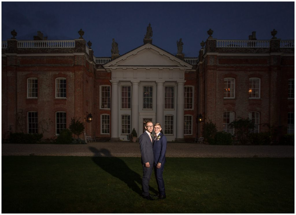 Same sex wedding in Winchester - the couple outside the manor house at dusk
