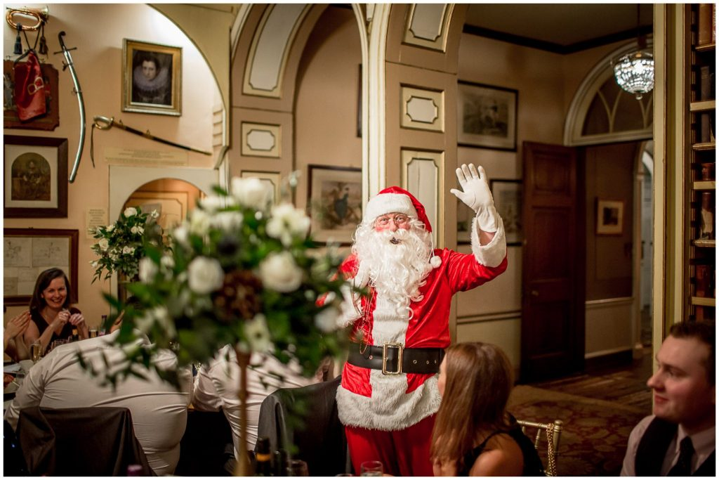 Santa makes a special appearance at a Christmas wedding