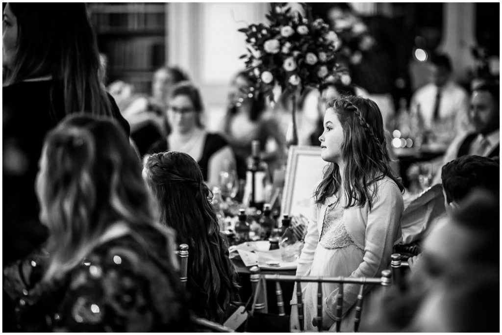 Flower girl watching the speeches black and white portrait
