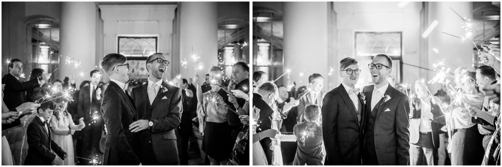 Black and white photos of sparkler walk for the two grooms at Winchester same sex wedding
