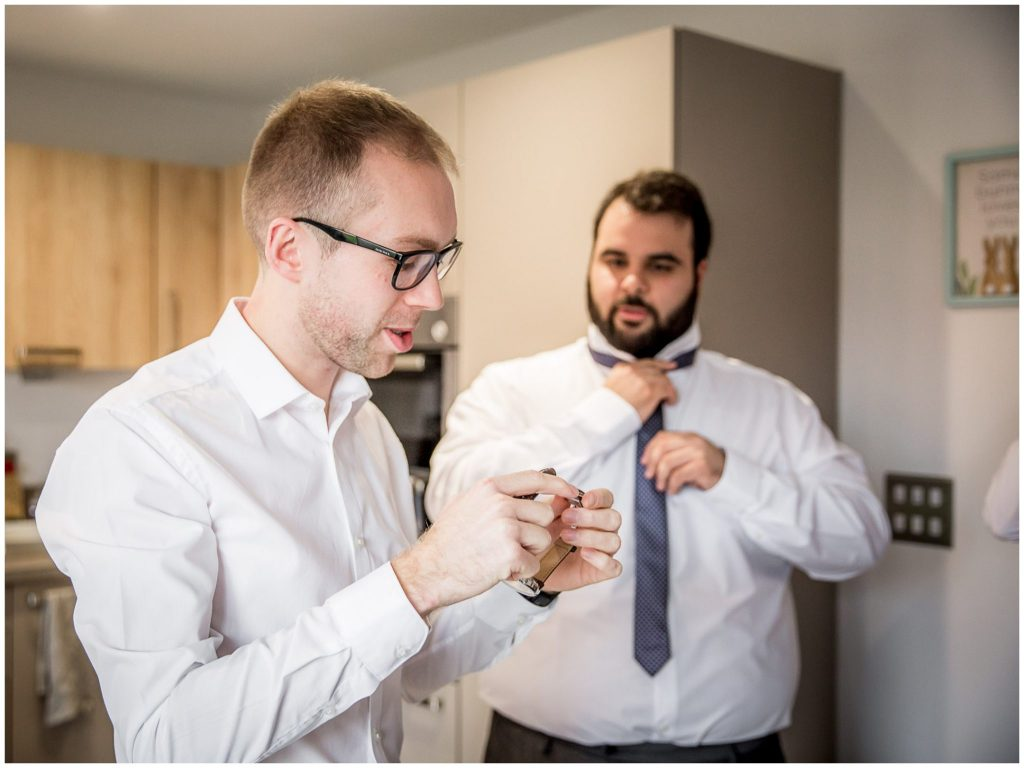 Groom receives a watch as a wedding gift