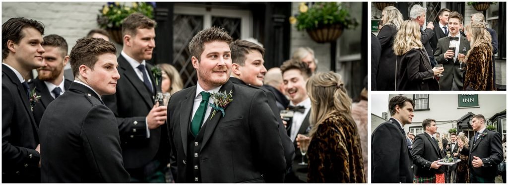 The groom greets arriving guests at a pub near the church
