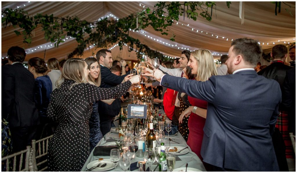 Guests toast the bride and groom