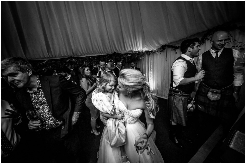 Bride with flower girl on the dancefloor