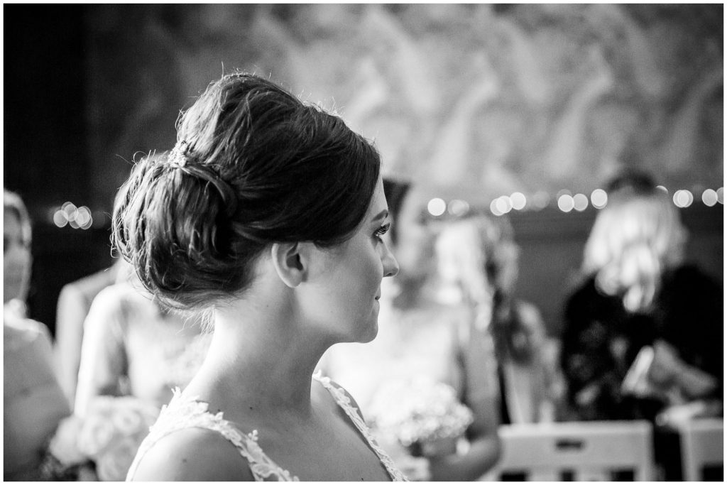 Black and white portrait of bride at start of ceremony