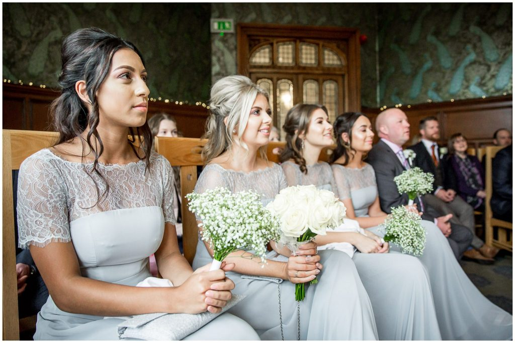 Bridesmaids watching a wedding in the Basing Room
