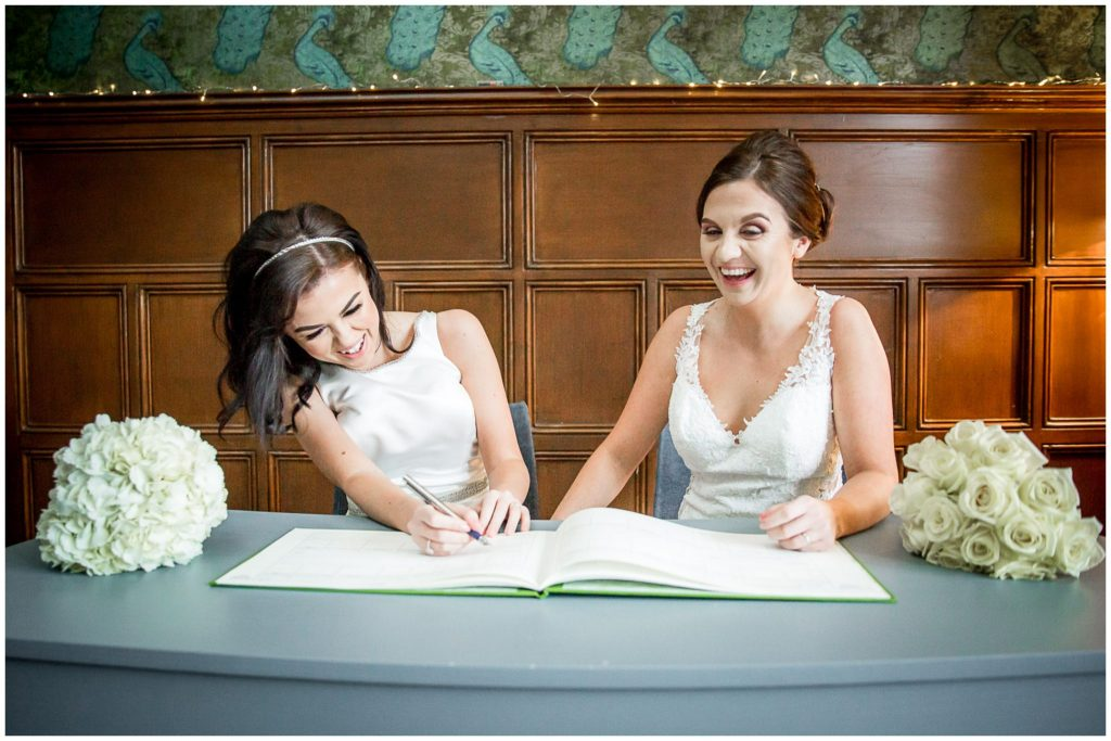 Laughter during the signing of the register