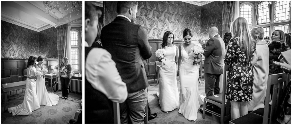 The brides receive their marriage certificate and walk down the aisle together