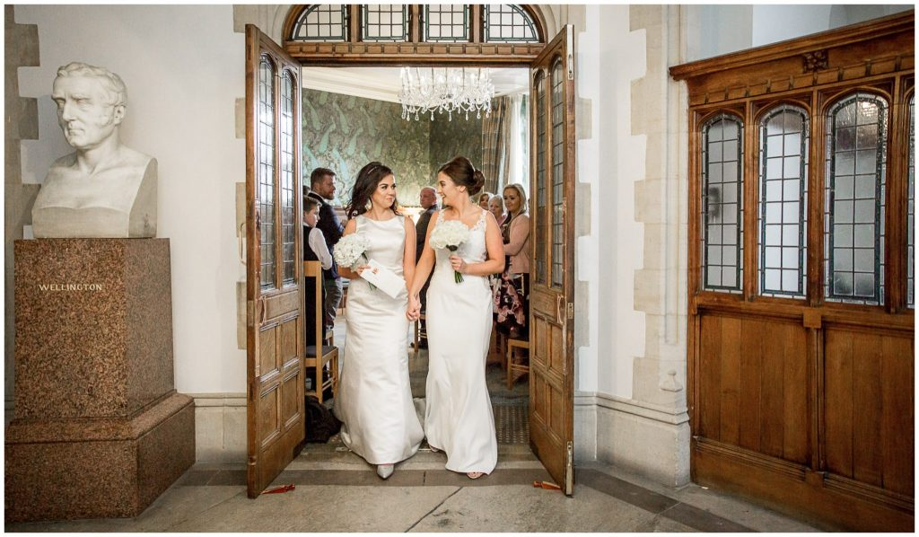 The two brides exit the ceremony room together