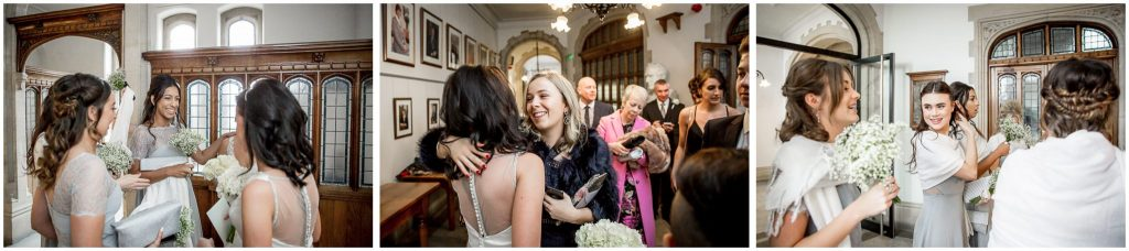 Brides congratulated by guests outside the Basing Room