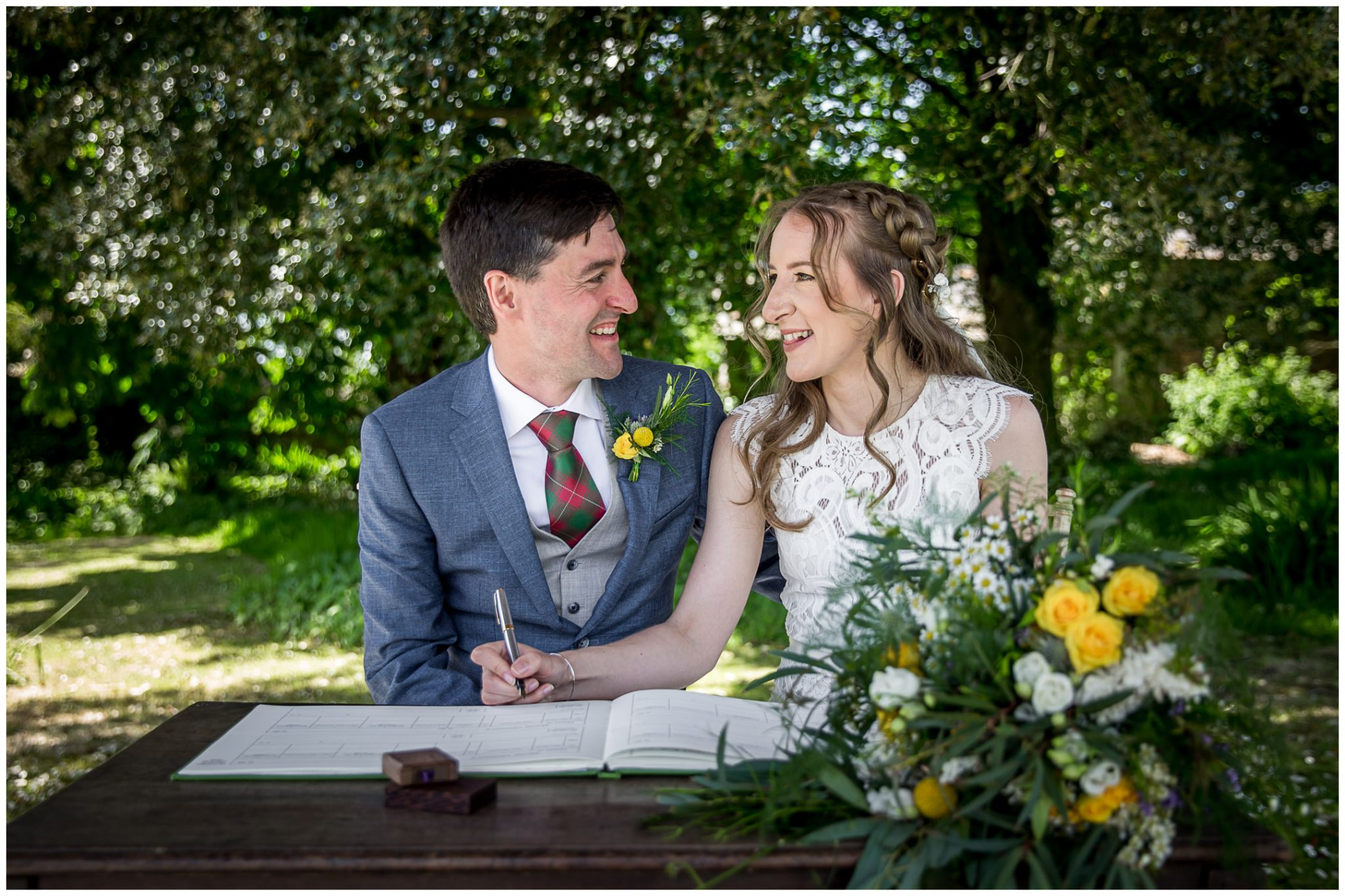 Signing of the register at Bude Cornwall outdoor wedding ceremony
