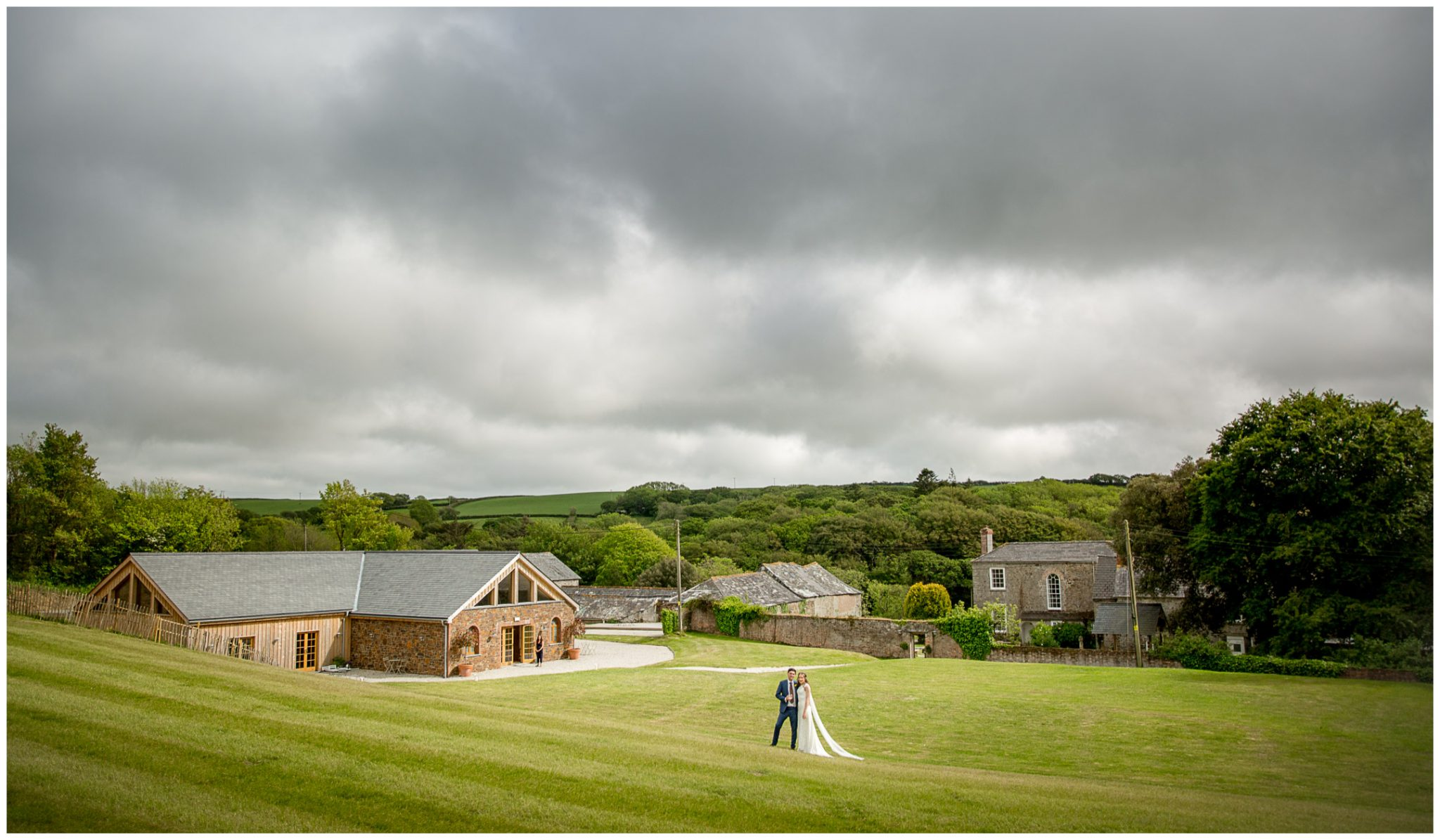 Bride and groom portrait with Cornwall countryside views