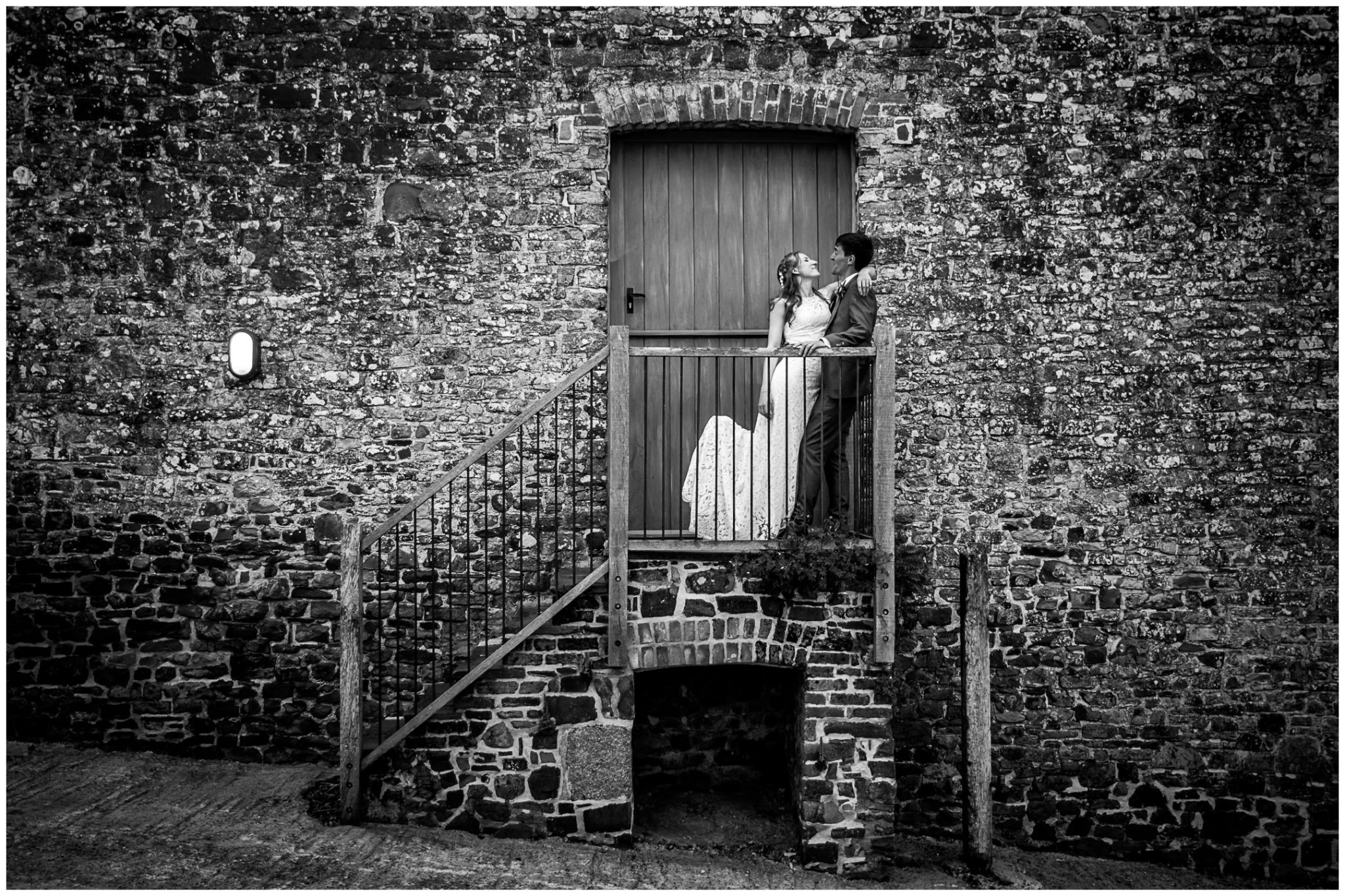 Couple portrait black and white on barn steps