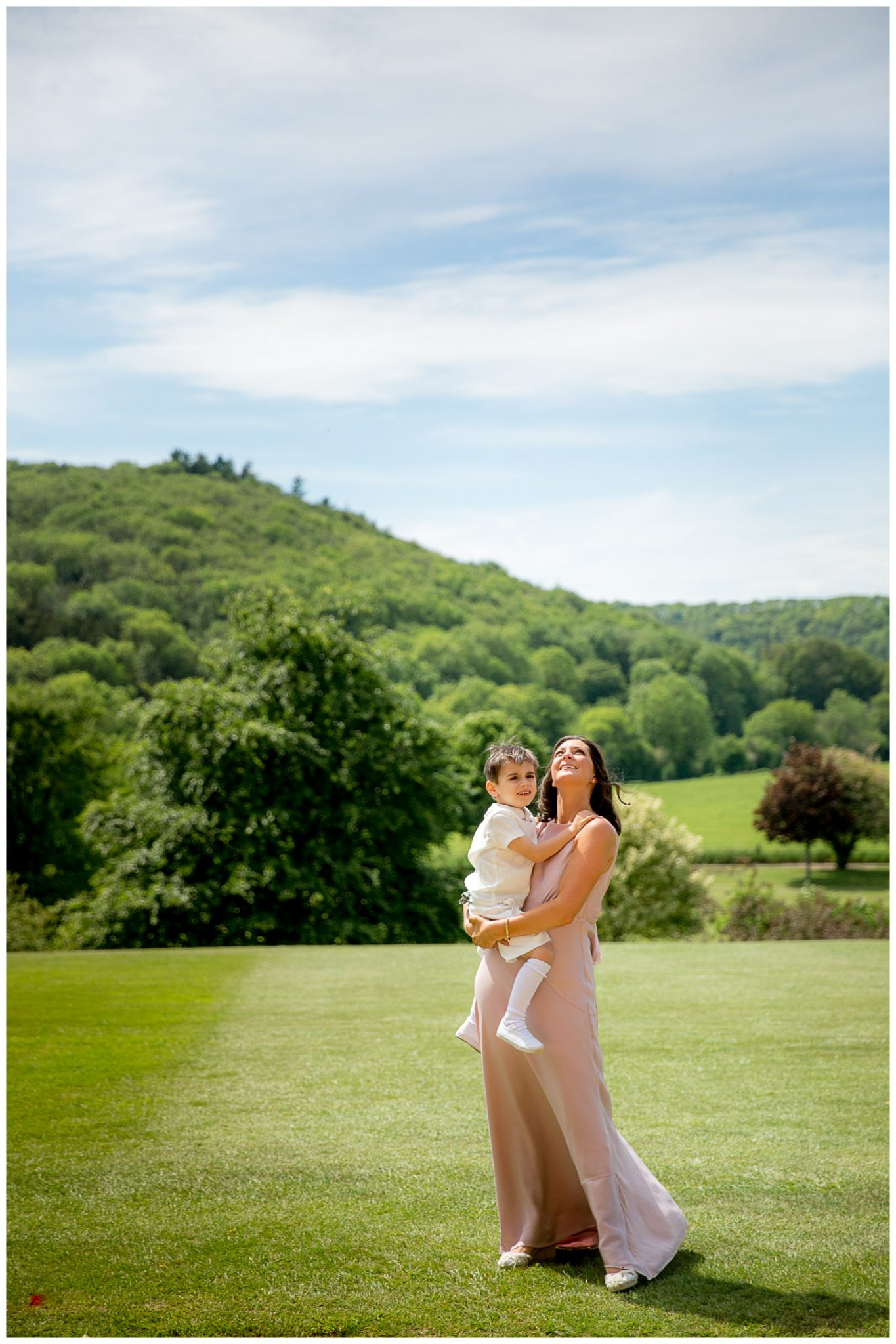 A bridesmaid and age boy admire the view across the Dorset countryside