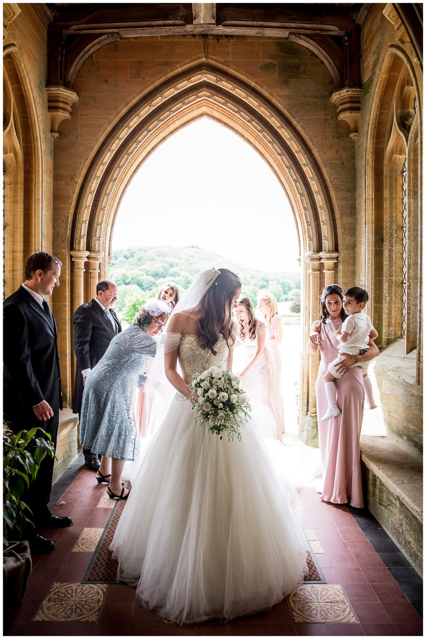 Finishing touched to the bride's dress and veil as she enters the Abbey ready fir the marriage ceremony.