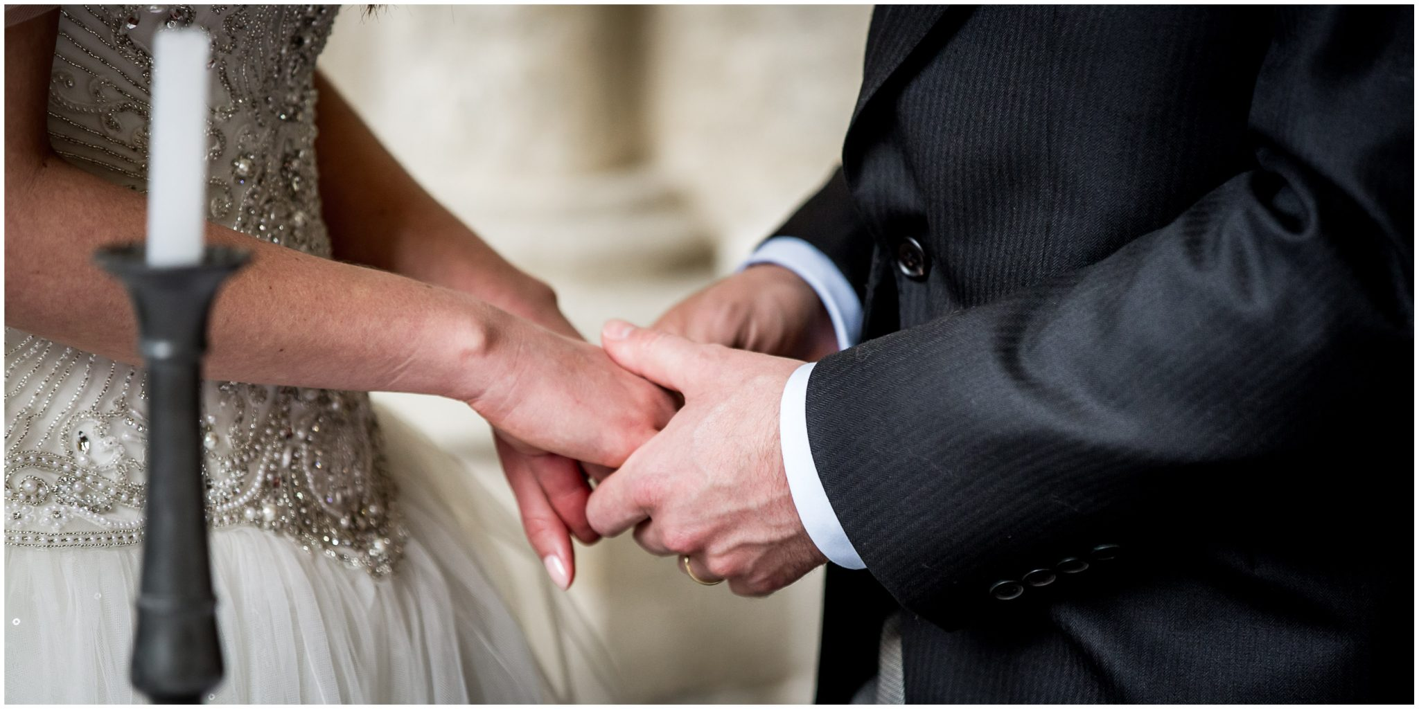 The couple hold hands while they wait to sign the register
