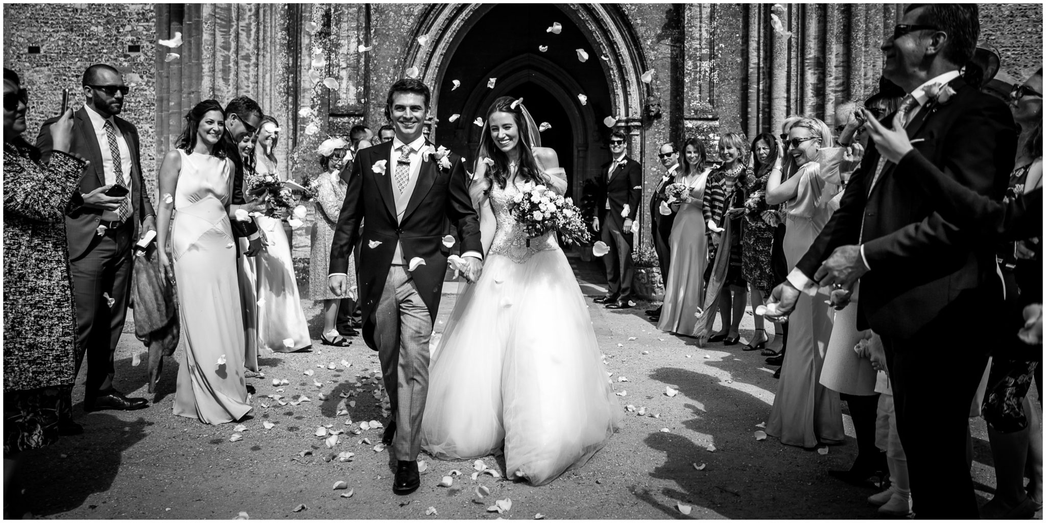Bride and groom exit church to confetti