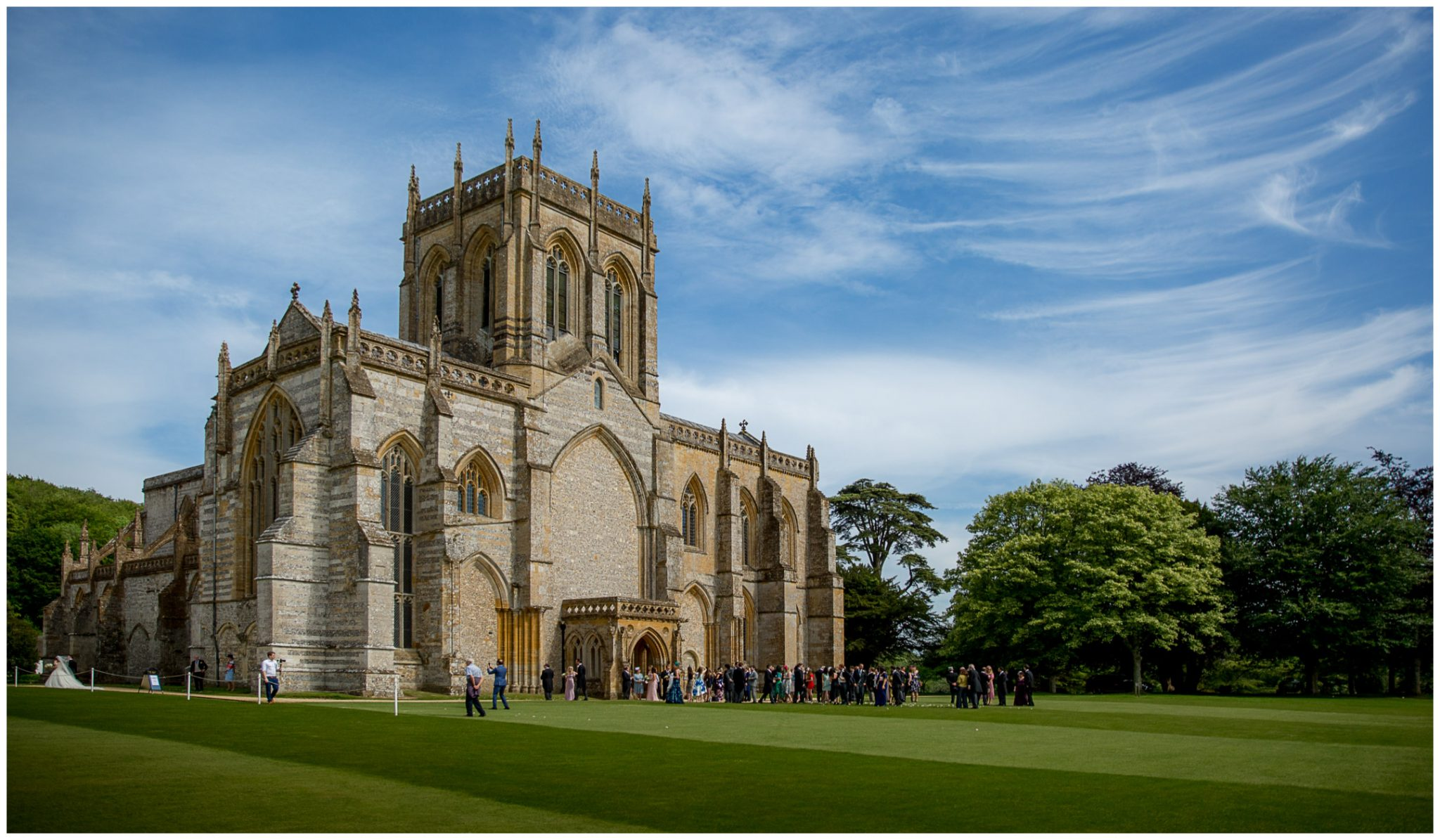 Guests congregate outside the Abbey after the service