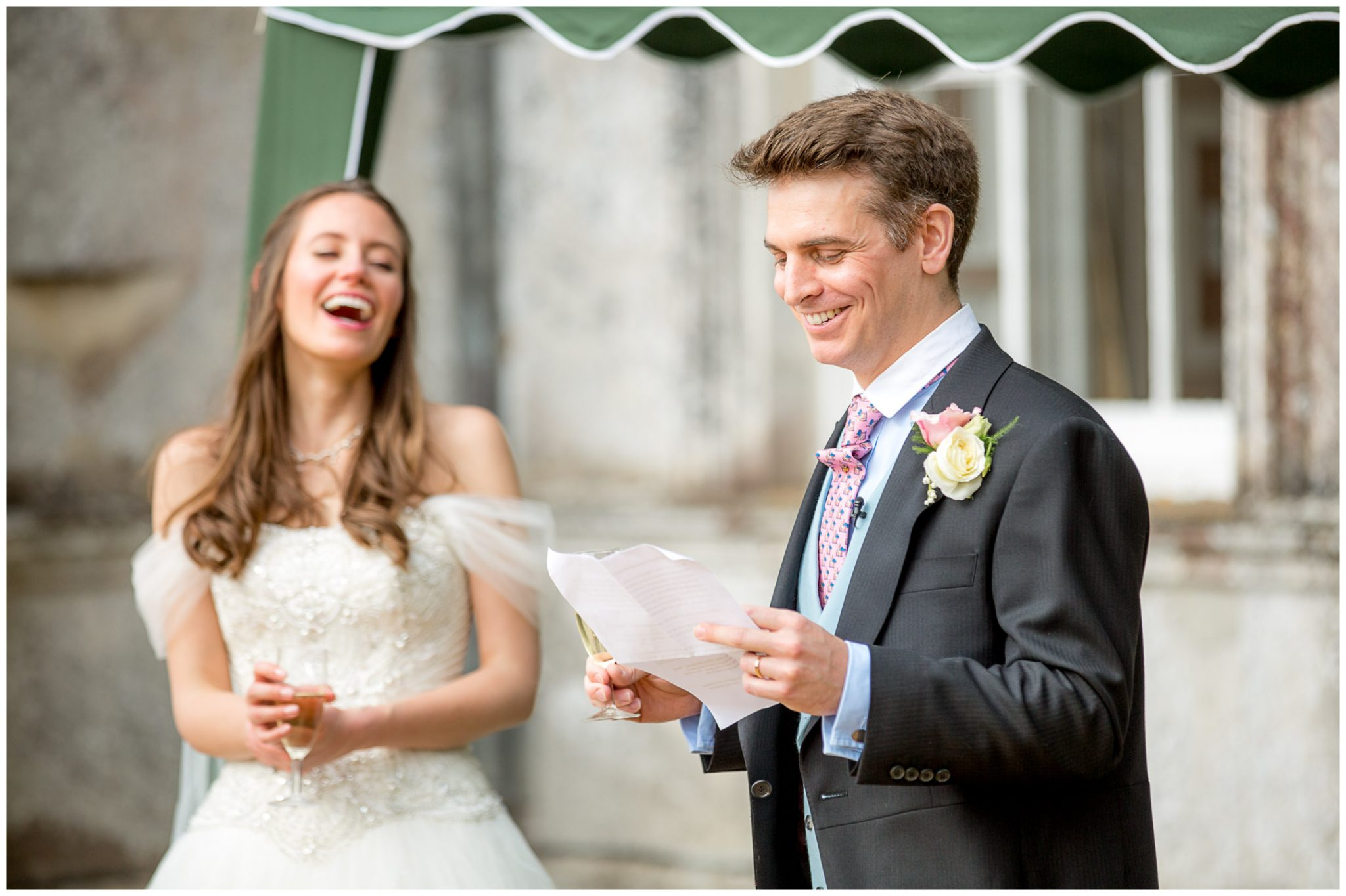 Bride laughs as the groom makes his speech
