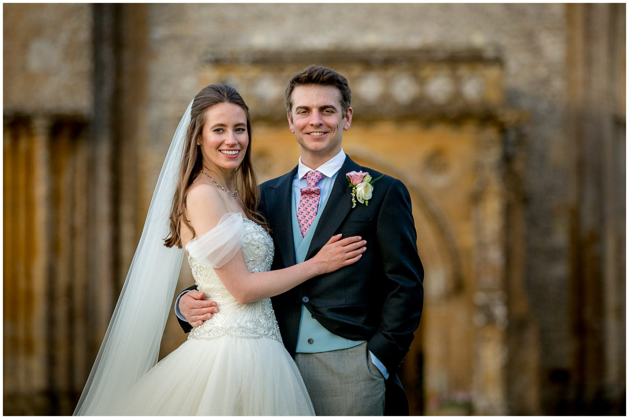 Bride and groom portrait in front of Milton Abbey