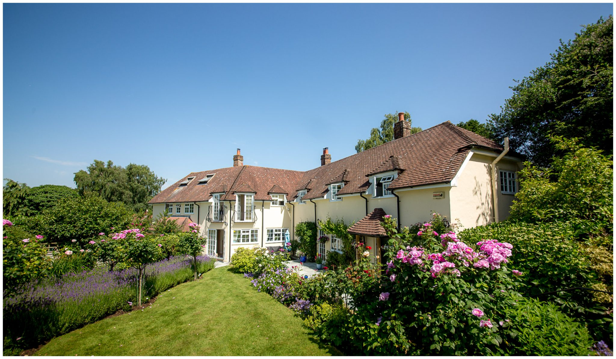 Family home gardens in the Summer sunshine for bridal preparations