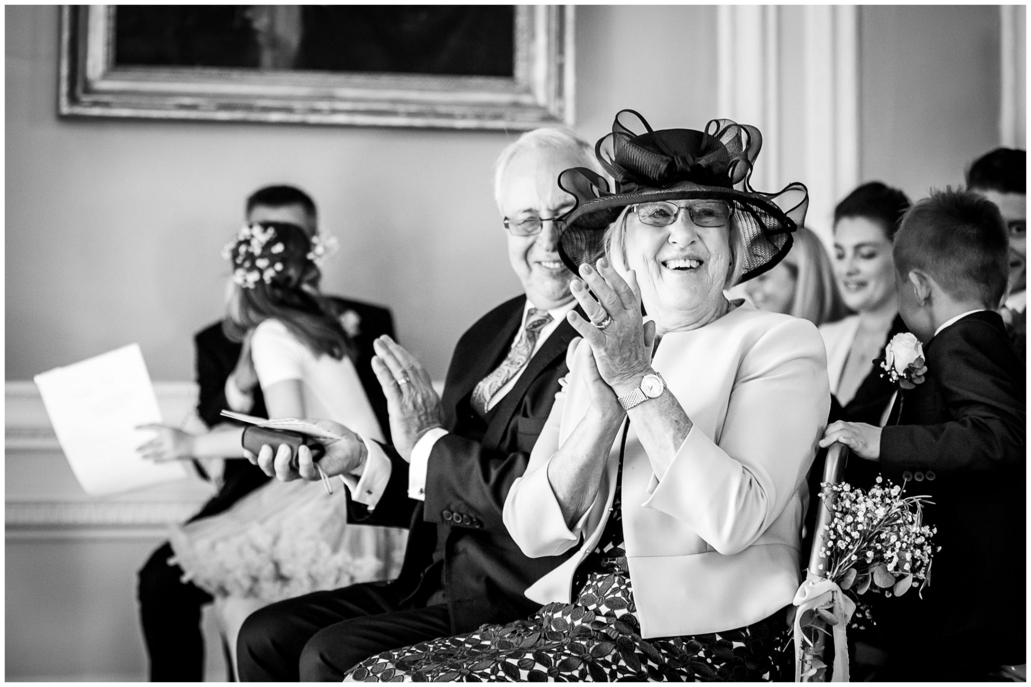 The mother of the groom applauds a reading