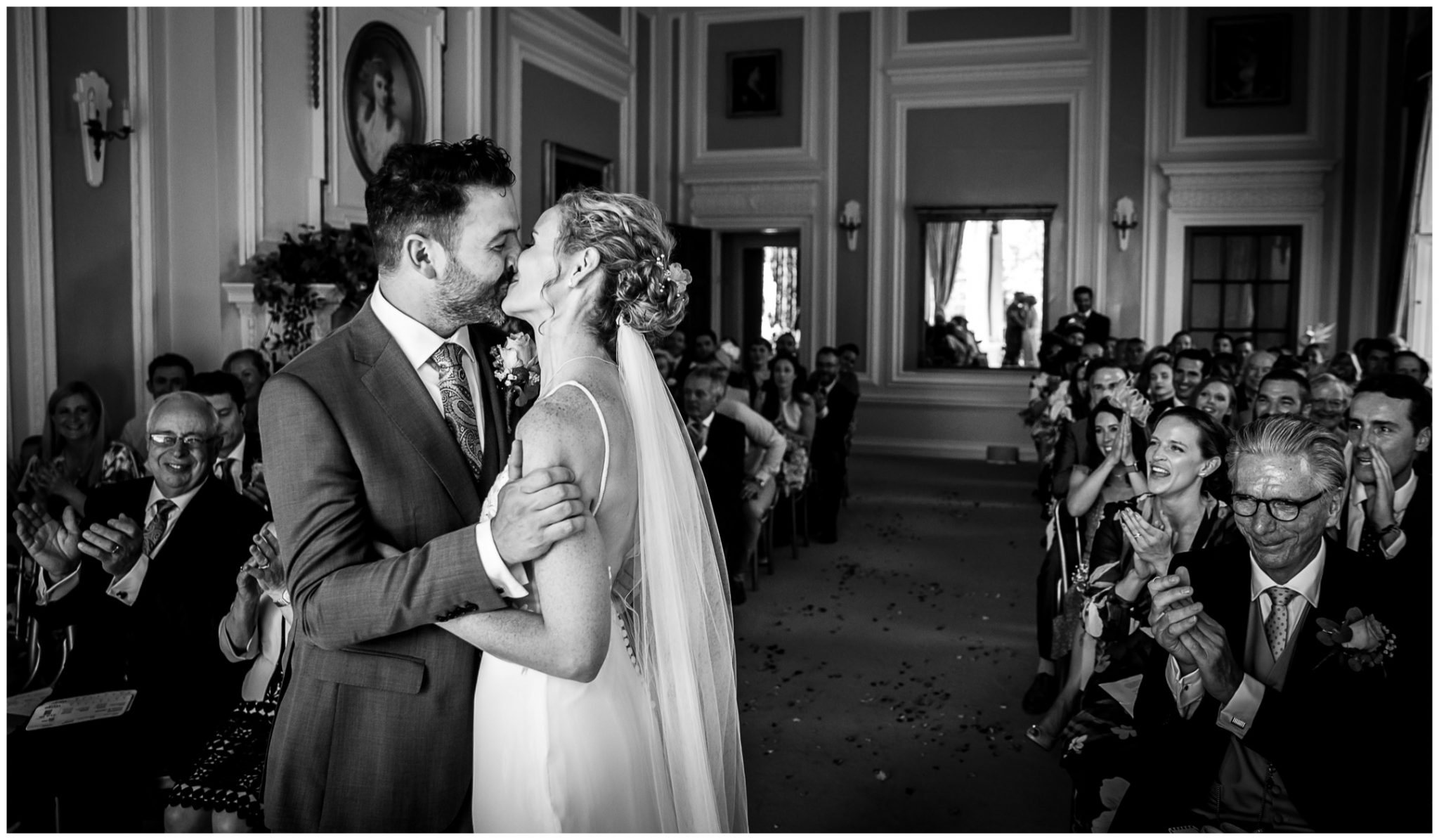 The first kiss of the newly married couple as they are announced as husband and wife