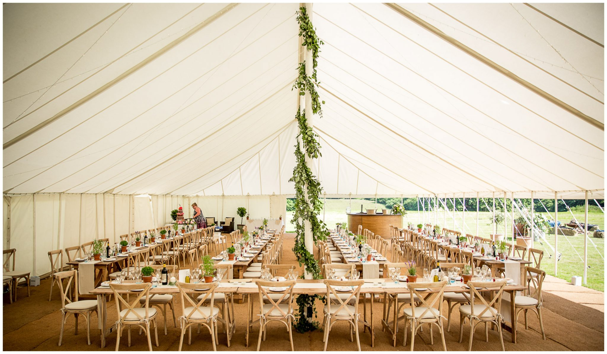 Wedding reception marquee set up in a banqueting style