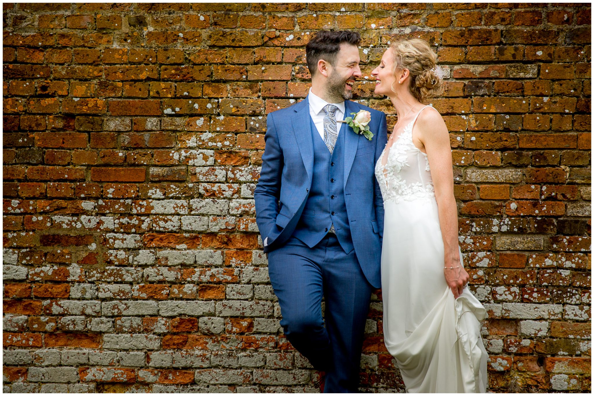 Colour portrait of wedding couple against brick textures