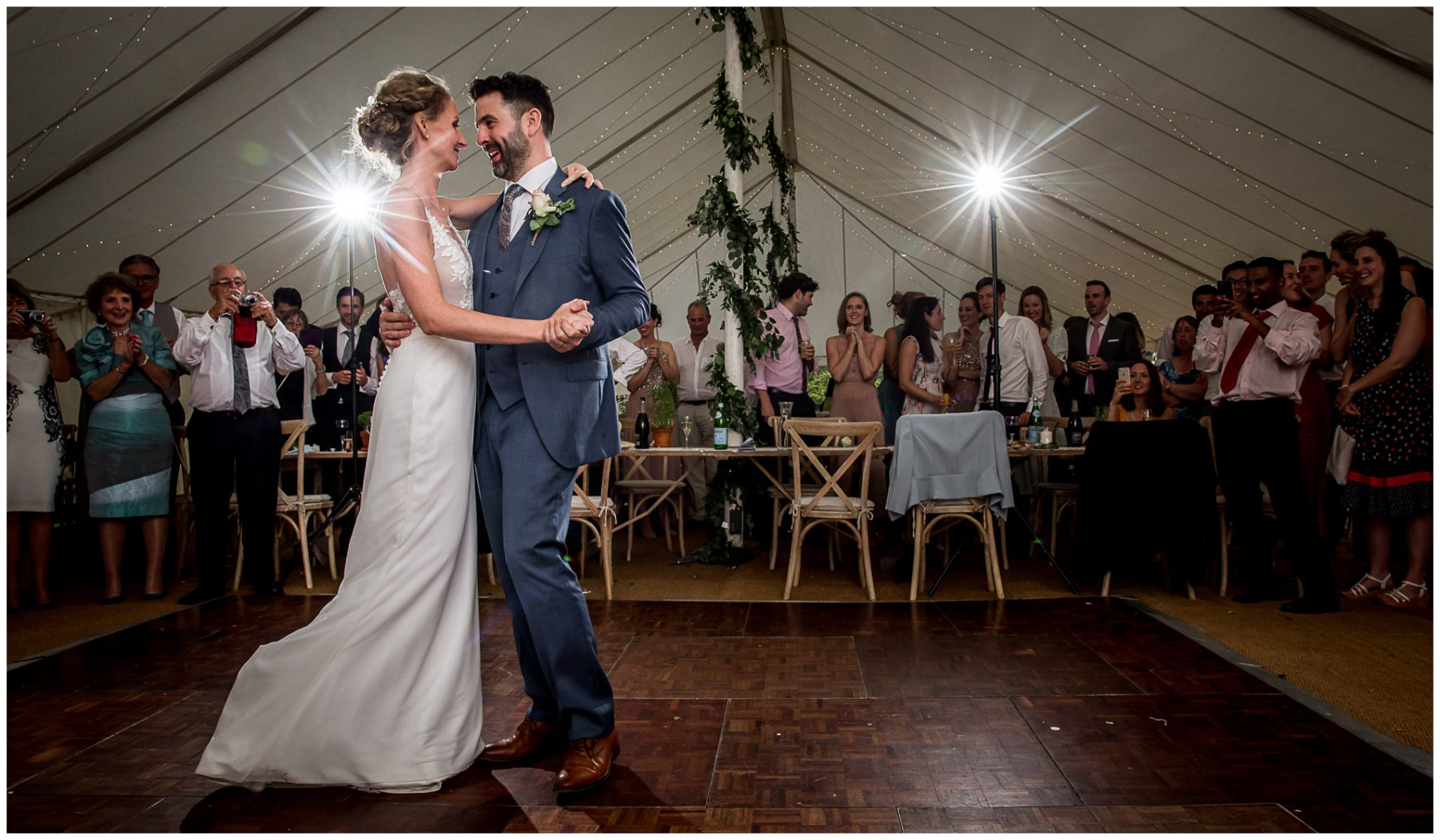 The wedding couple's first dance at a marquee reception