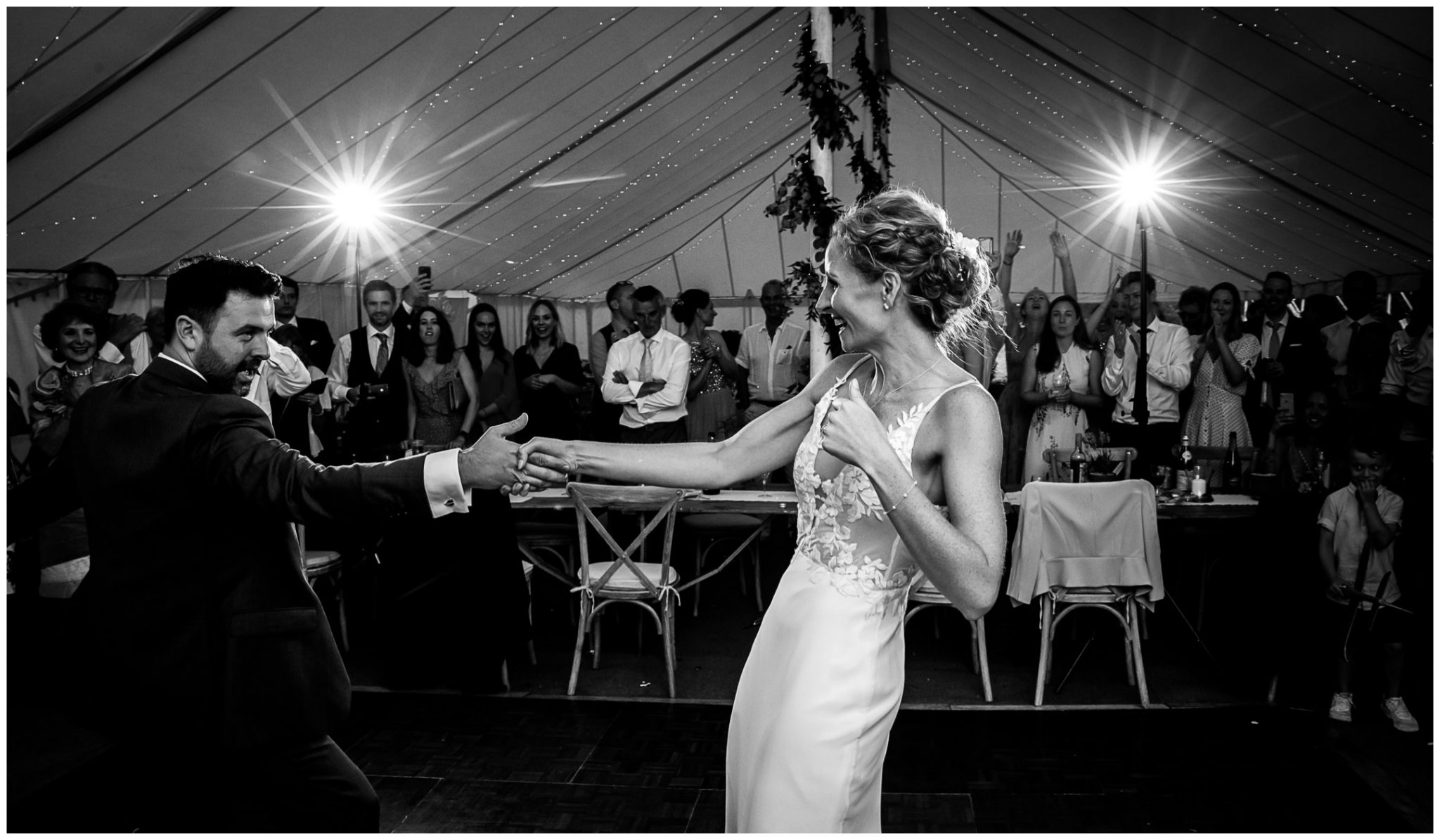 Black and white photo of wedding couple's first dance