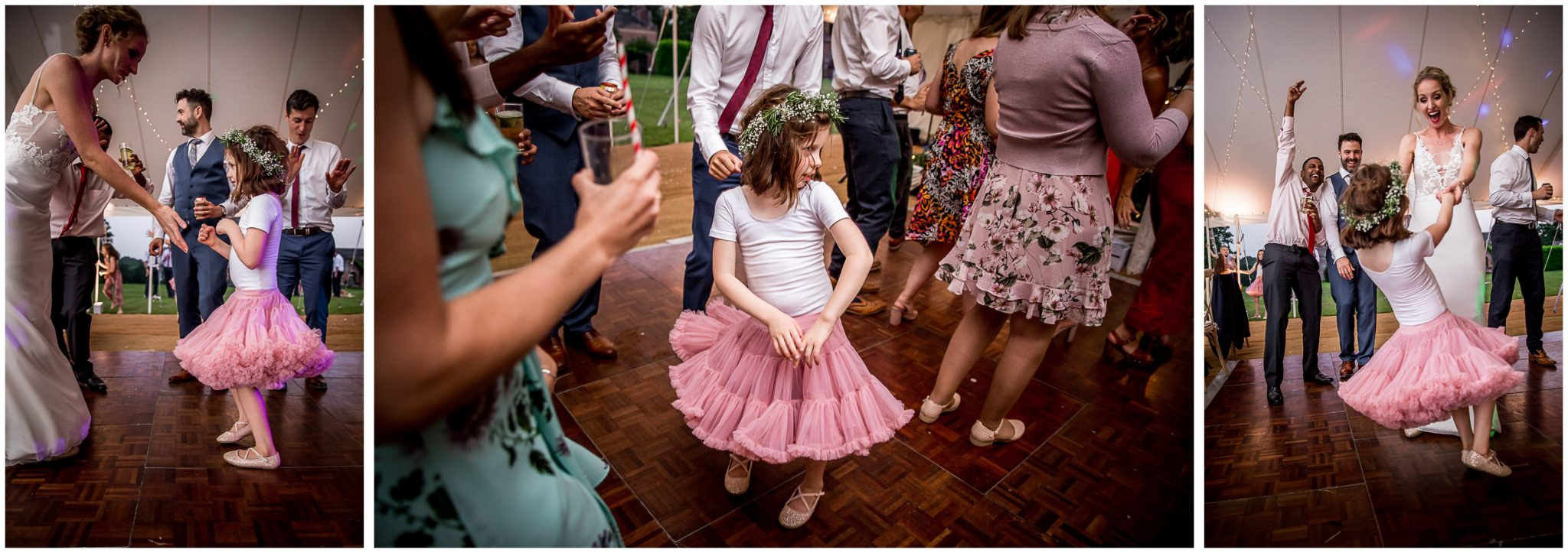 Bride dancing with flower girl at evening wedding reception
