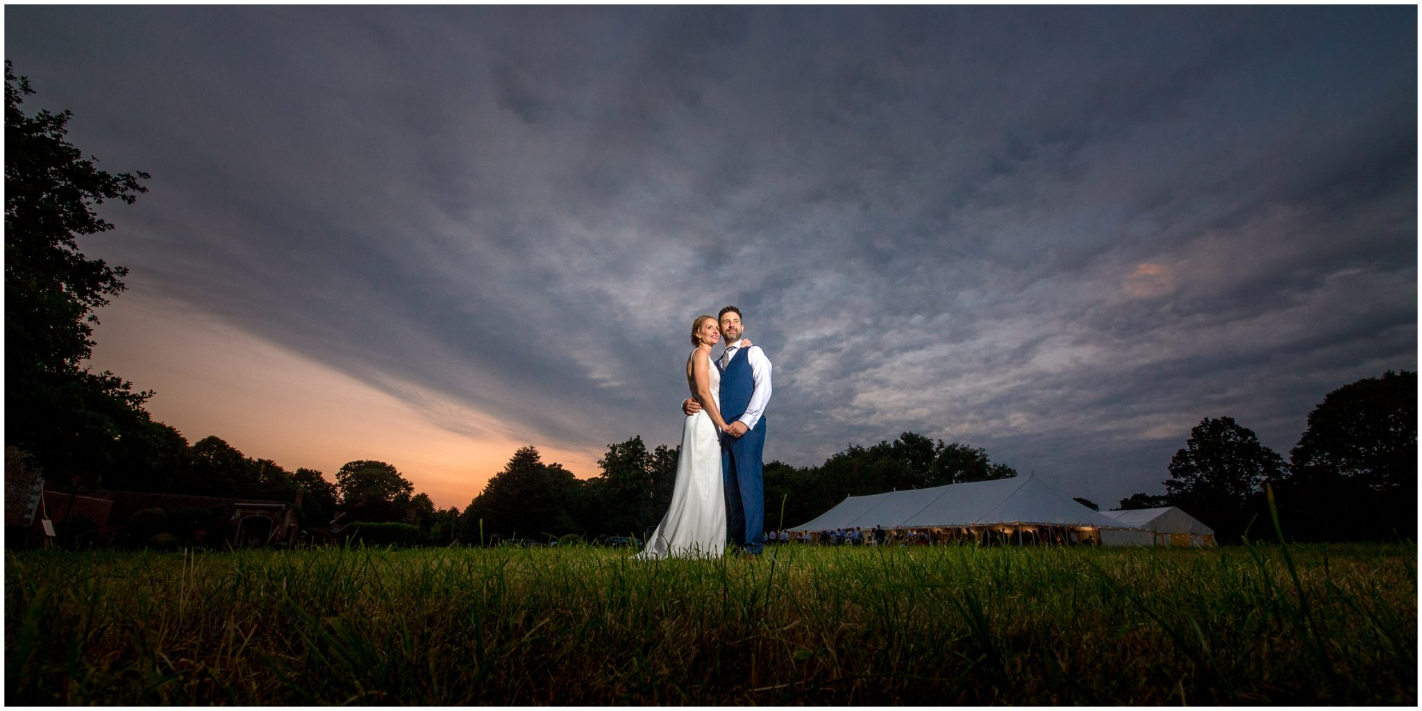 Bride and groom portrait at sunset