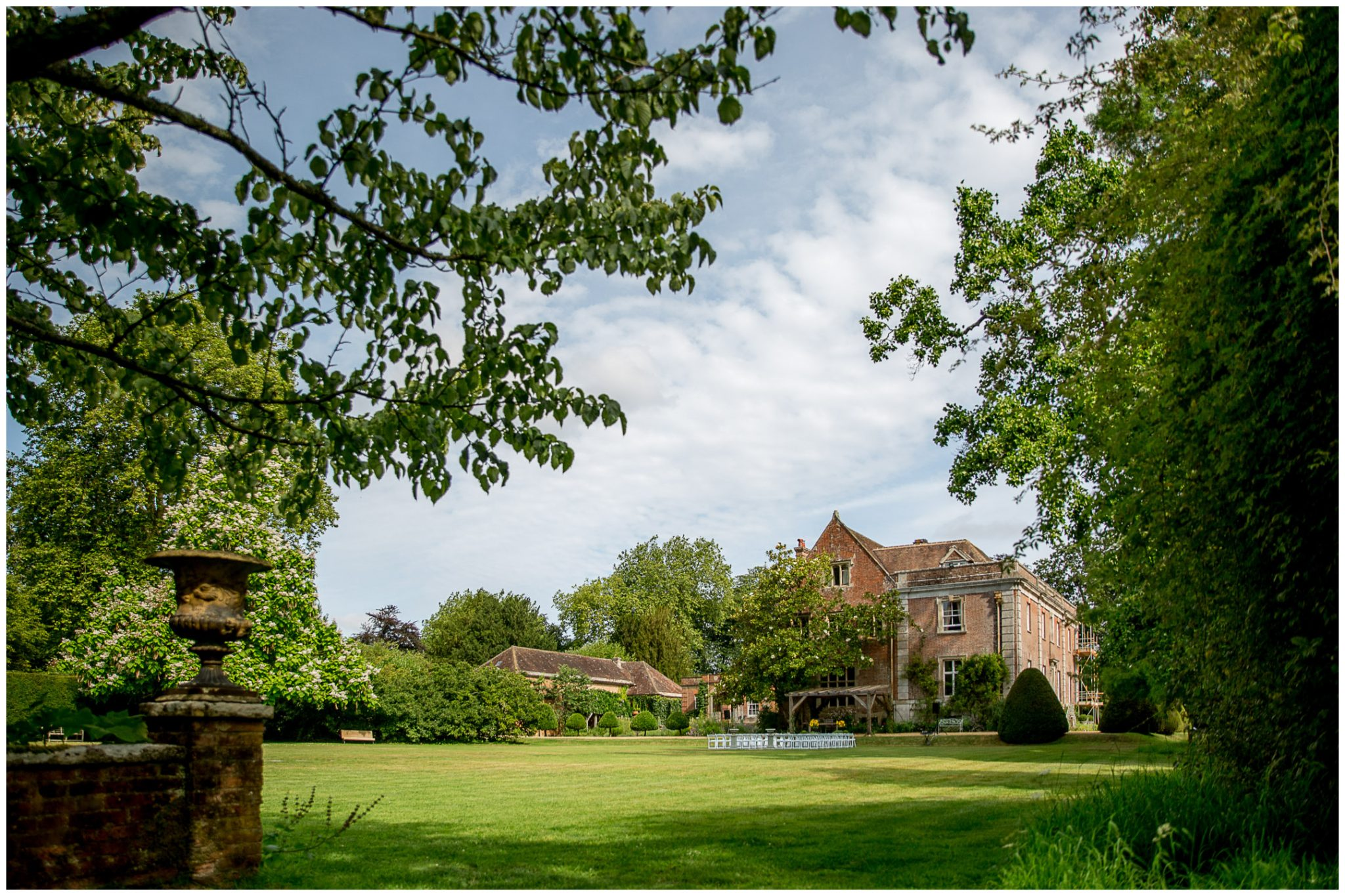 View of the Deans Court house and grounds from the rear set up for an outdoor marriage ceremony
