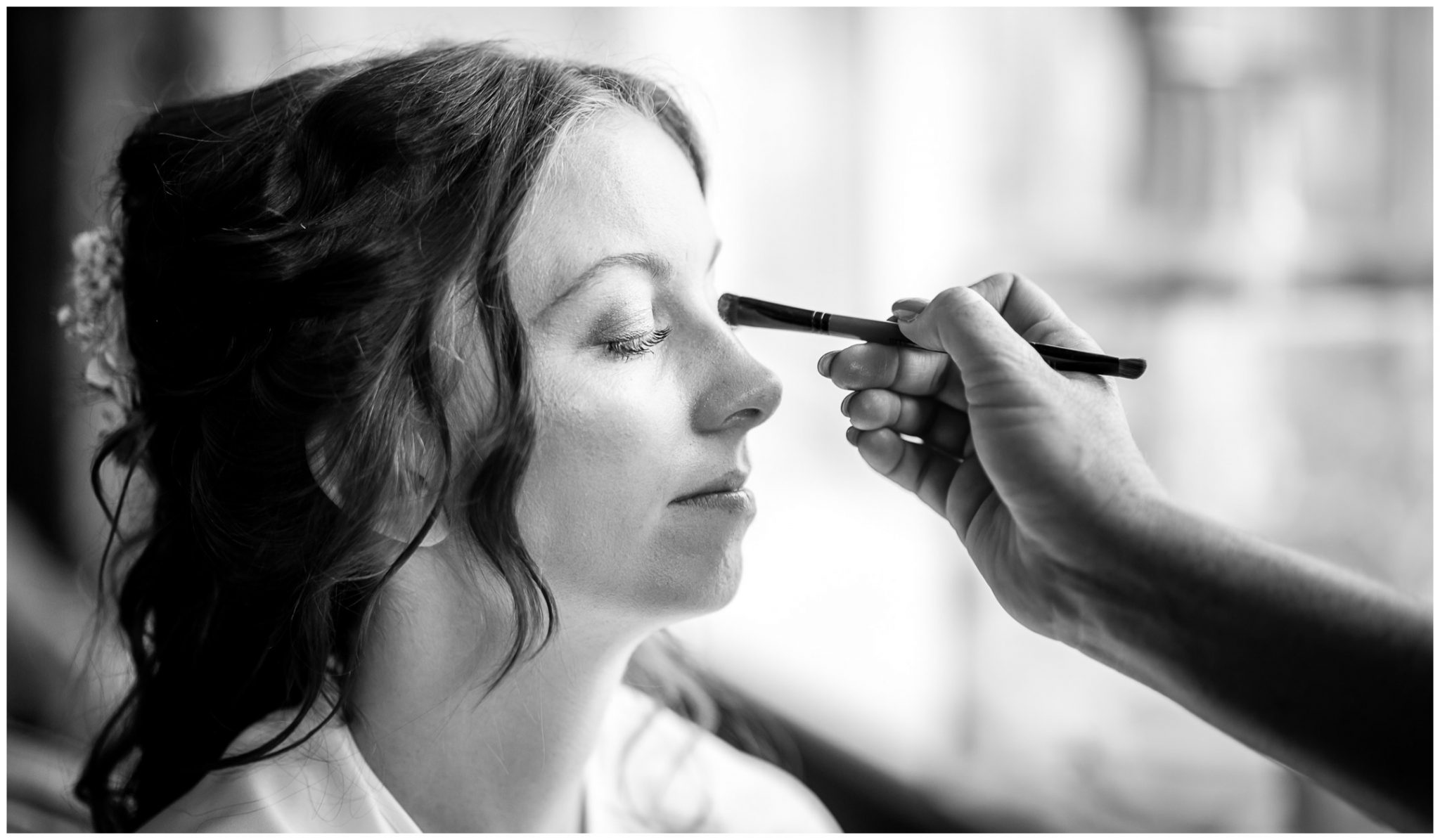 The bride has her make up touched up