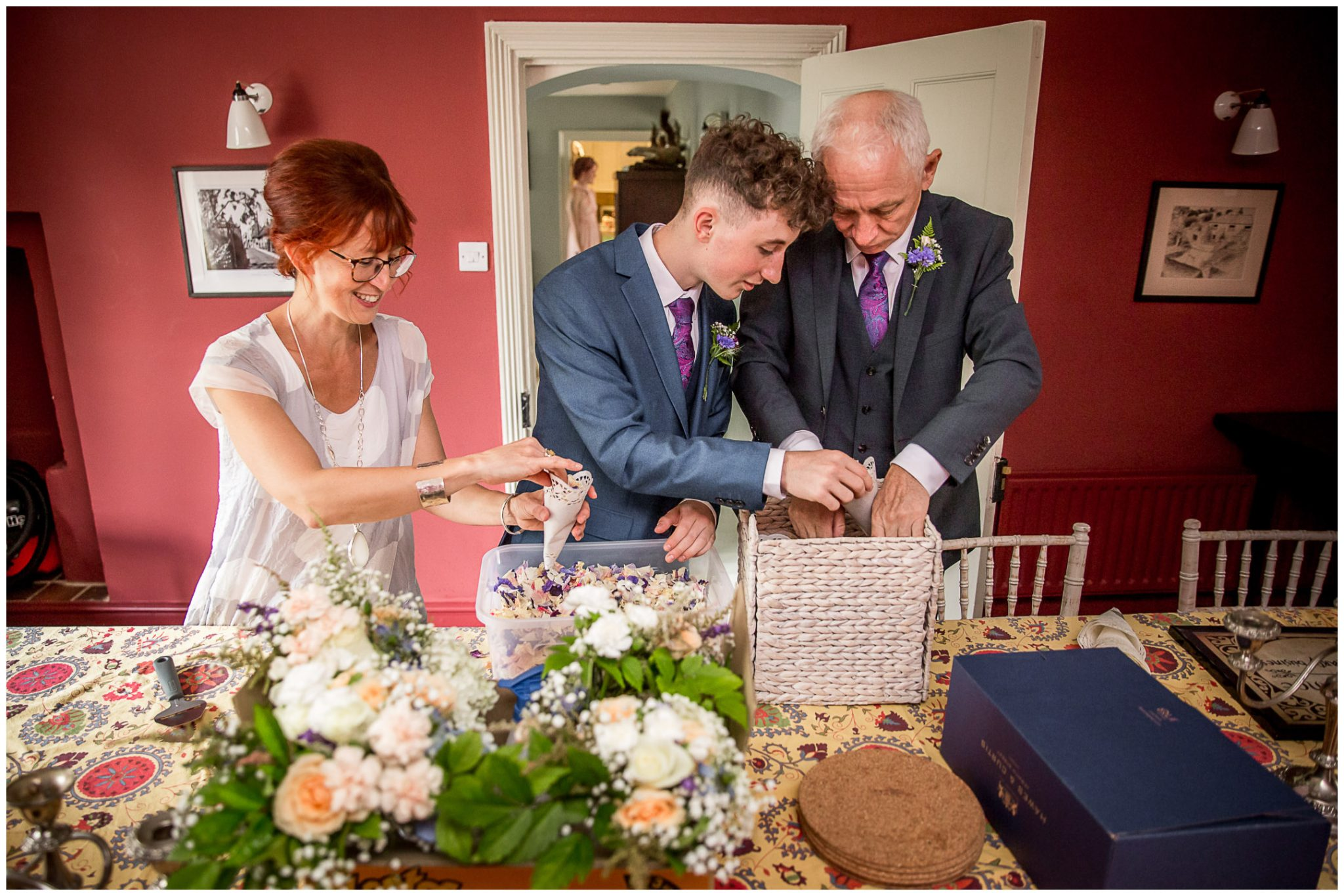 The bride's family prepare the confetti as the bride gets ready