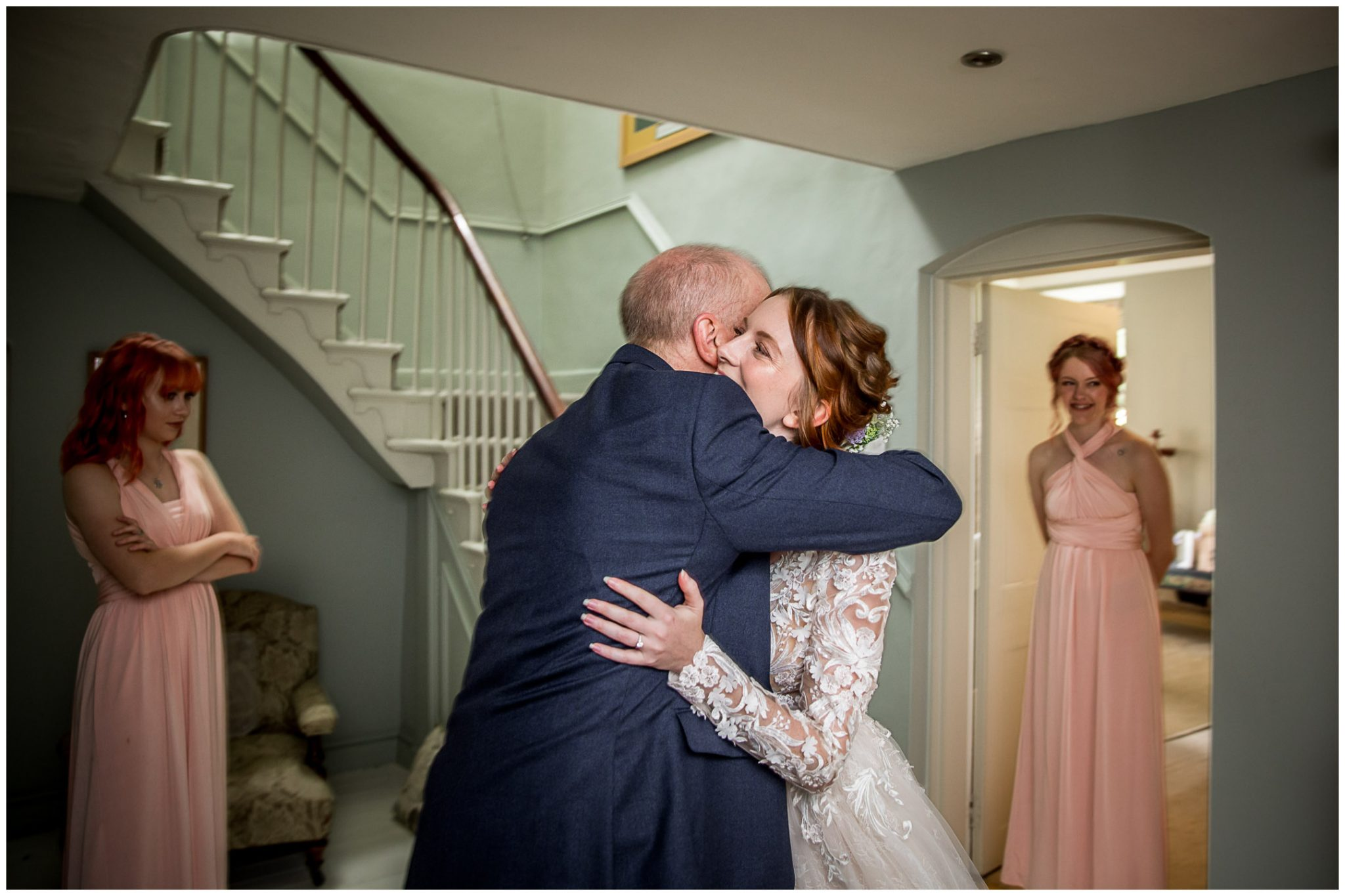 Father of the bride sees his daughter in her wedding dress