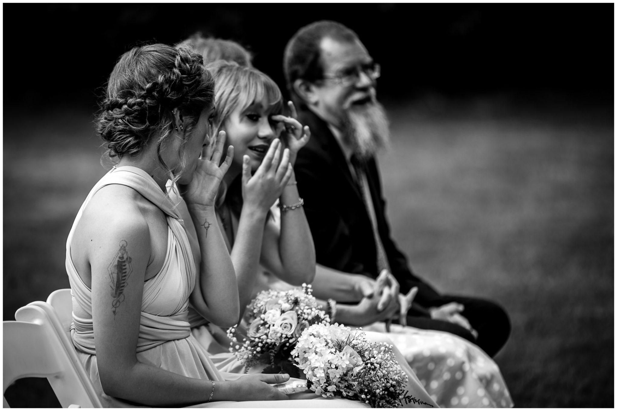 Bridesmaids shed a tear while watching the marriage take place