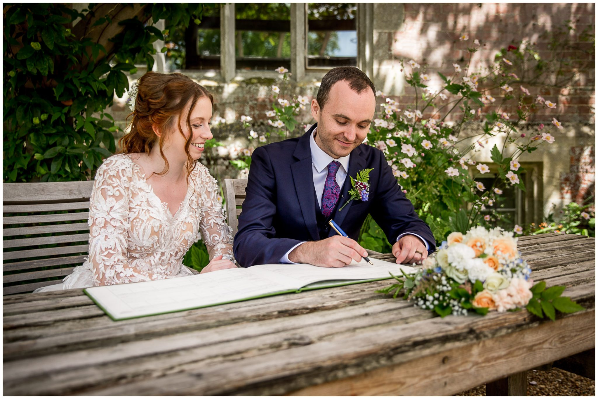 The couple signing the register