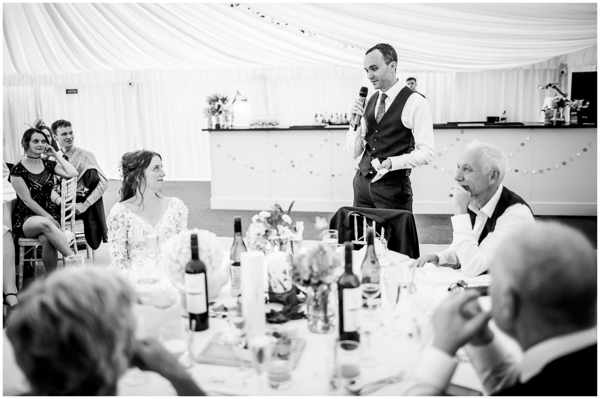 Bride watches on as the best man gives his speech