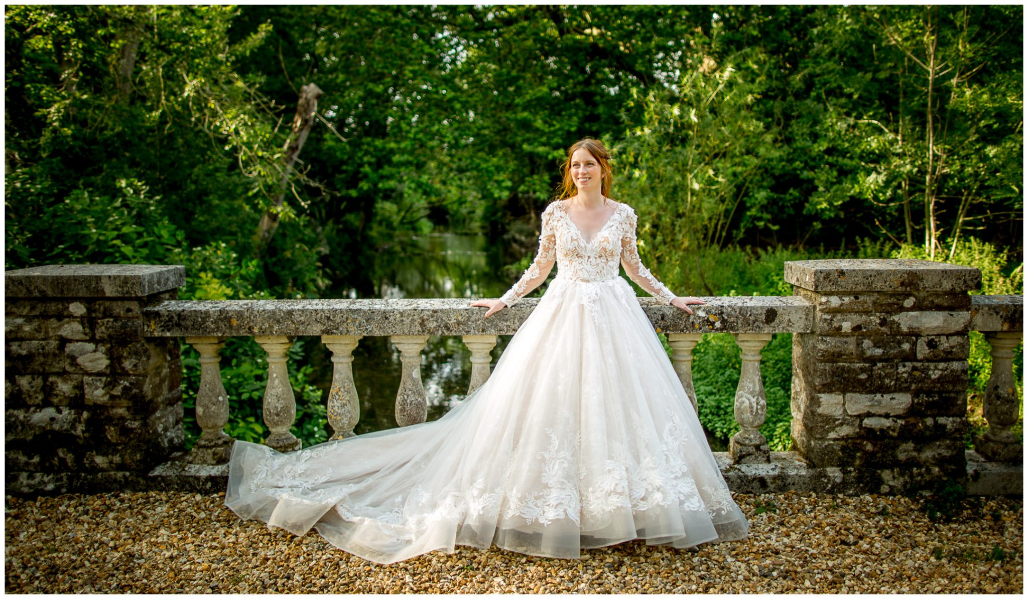 Bride portrait on bridge with river behind
