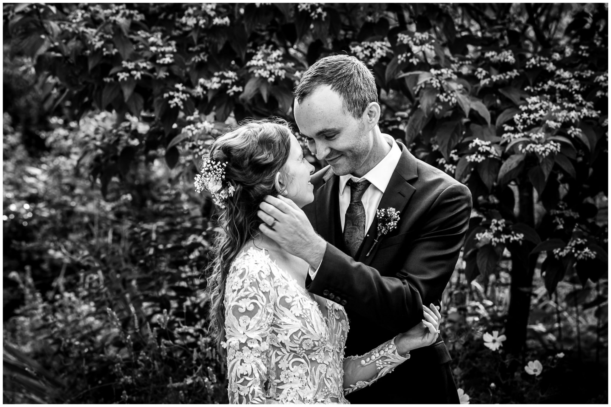 Black and white photo of bride and groom togethedr