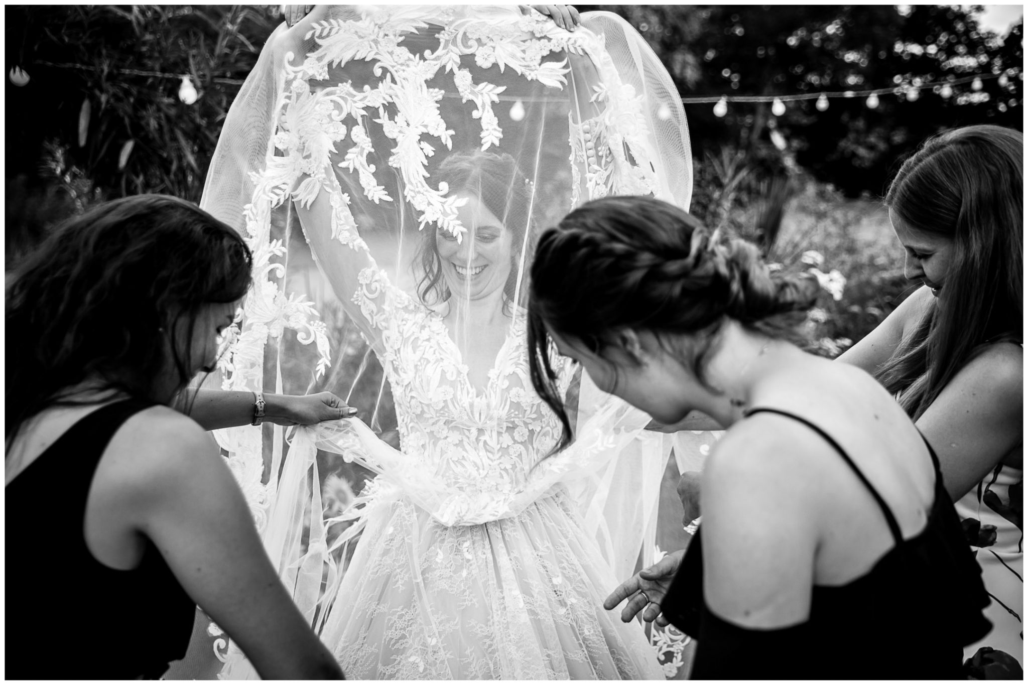 Guests examine the bride's wedding dress